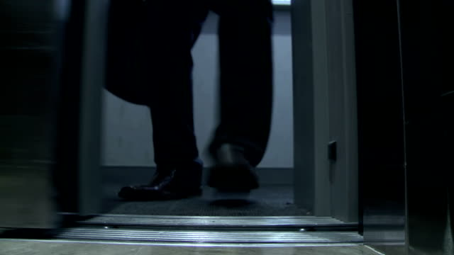 HD: Businessman Blocking Elevator Doors video