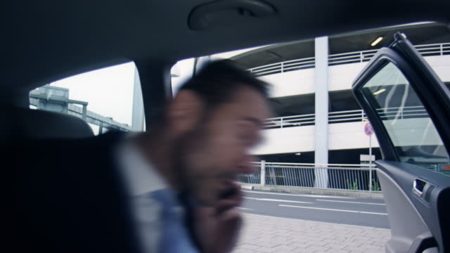Businessman boarding car video