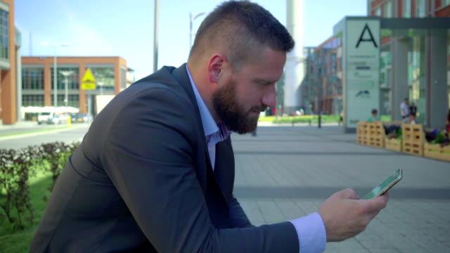 Businessman browsing smartphone, close shot