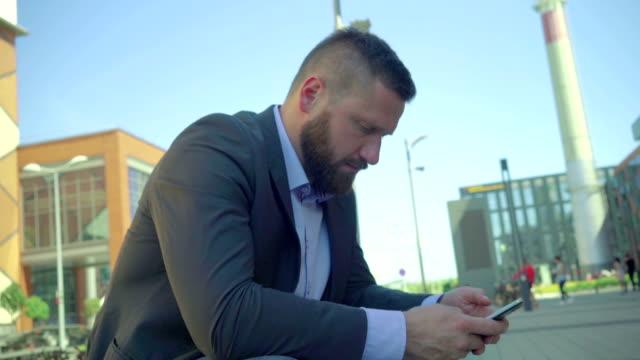 Businessman browsing smartphone