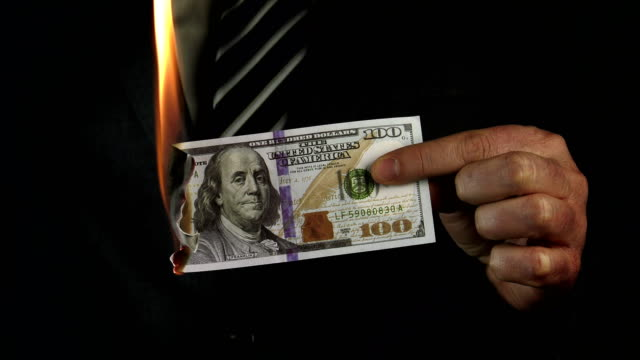 businessman burns money - bankruptcy stock videos and b-roll footage