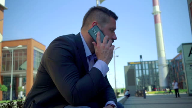 Businessman calls on the smartphone.