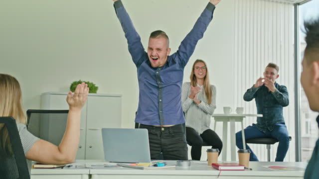Businessman Celebrating Victory Looking at Laptop video