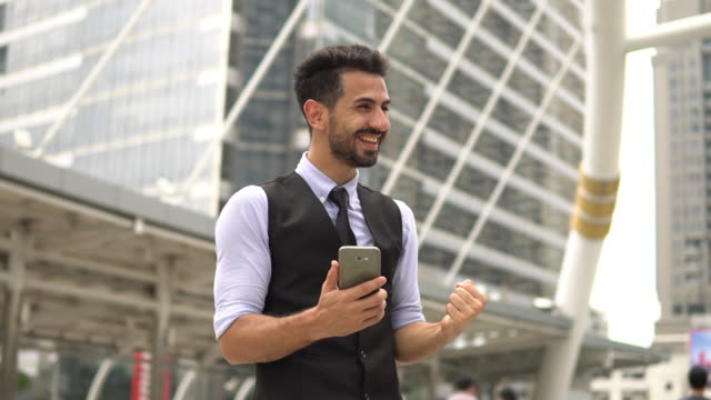 Businessman Celebrating Victory Looking at smartphone Businessman Celebrating Victory Looking at smartphone good news stock videos & royalty-free footage