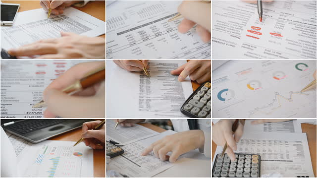 Businessman checking financial report and charts in the office video