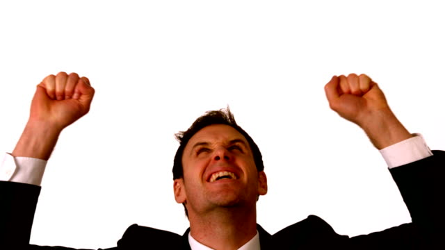 stockvideo's en b-roll-footage met businessman cheering on white background - overhemd en stropdas