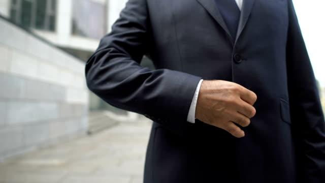 businessman clenching fist after successful job interview, proud of result - zaciskać filmów i materiałów b-roll