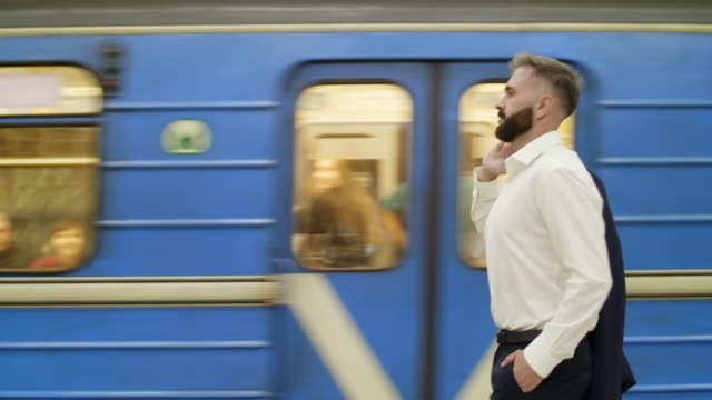 Businessman coming to metro station