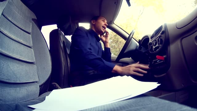 businessman conflict  man manager in car talking on the telephone bug swears failure documentation video