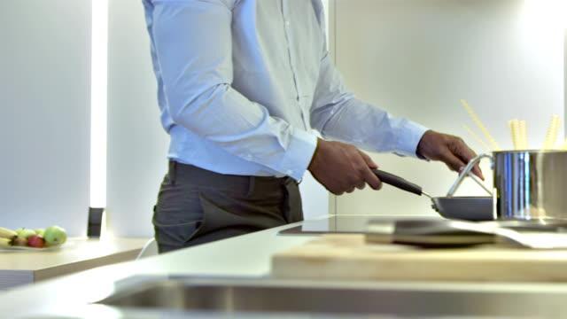 CU PAN Businessman Cooking Dinner After Work video
