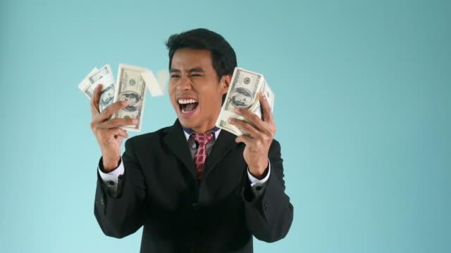 businessman counting cash money - bonus video stock e b–roll