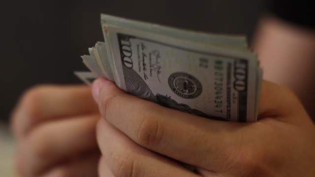 Businessman, counting money. American Dollar.