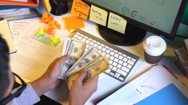 businessman counting money - bonus video stock e b–roll