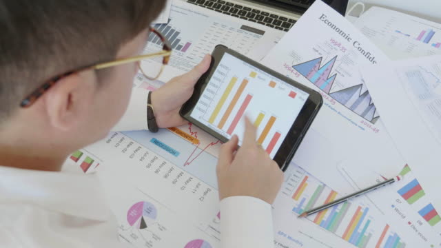 Businessman developing a business project and analyzing market data video