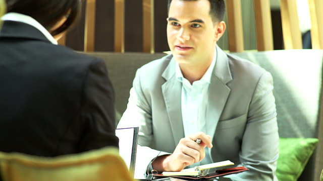 Businessman discuss about there business performance at coffee shop.Business concept video