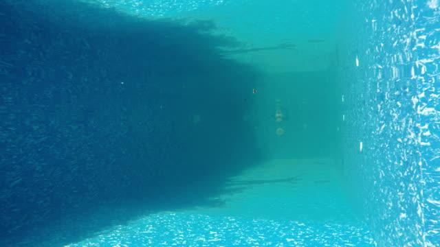 Businessman dives under water in suit video