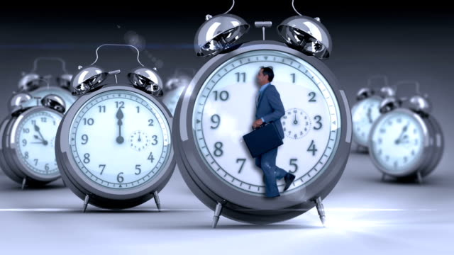 Businessman doing jogging in giant clock Businessman doing jogging in giant clock on grey background overworked stock videos & royalty-free footage