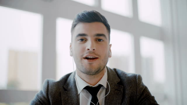 Businessman doing video call with partner