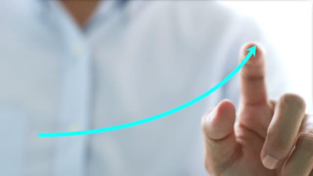 businessman draw rising graph