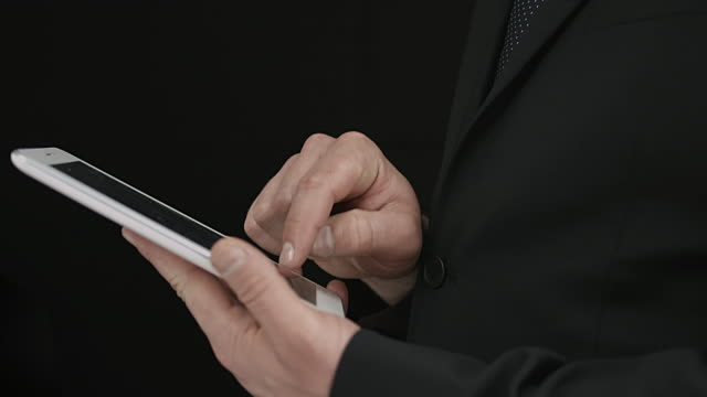 Businessman Dressed In Suit And A Blue Tie Using A Tablet video
