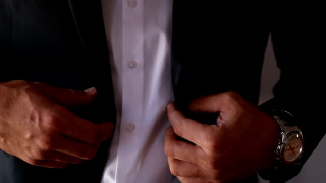 businessman dressing up a black suit - affluent lifestyles stock videos & royalty-free footage