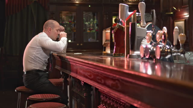 HD DOLLY: Businessman Drinking And Feeling Despair video