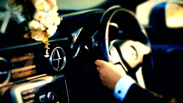 A businessman driving in the luxury car. video