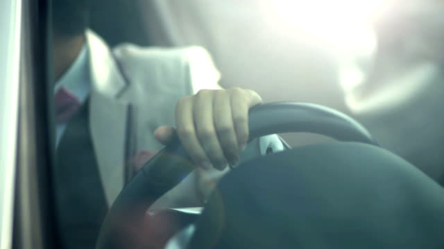 A businessman driving in the modern car. video
