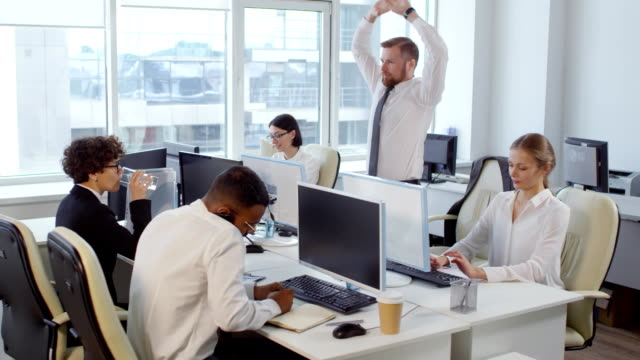 Businessman Exercising during Working Day