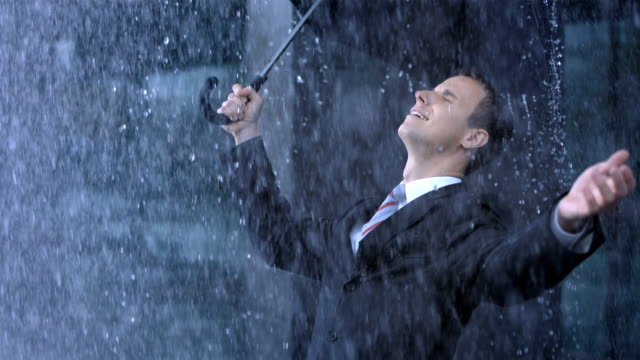 Businessman Exposing To The Rain video