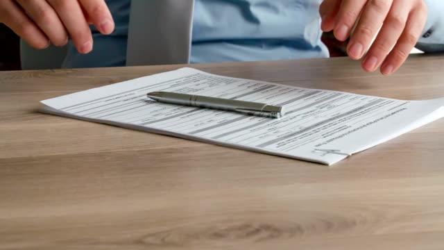Businessman Filling Tax Form video