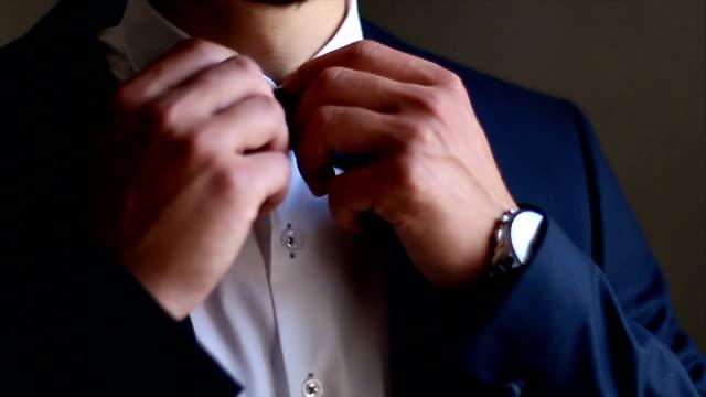 Businessman fixing his tie video
