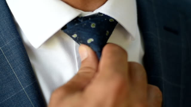 businessman fixing his tie - business suit stock videos & royalty-free footage