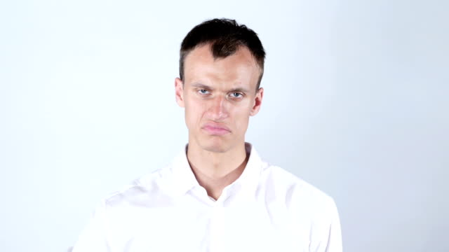 Businessman frowning and giving  thumbs down. video