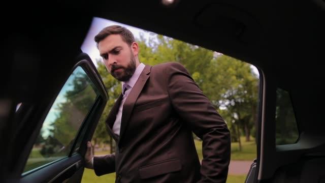 Businessman getting into car video