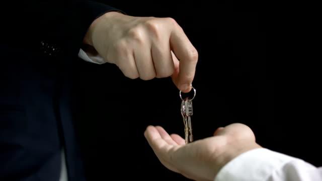 Businessman gives the keys video