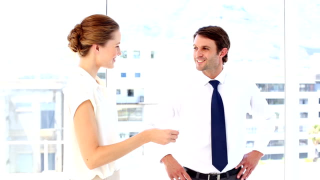 businessman giving card to businesswoman - business card stock videos & royalty-free footage