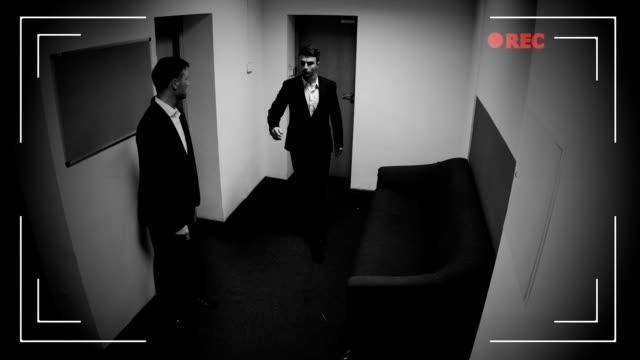 vídeos de stock e filmes b-roll de businessman giving envelope with money to his partner, bribe, cctv camera record - corruption