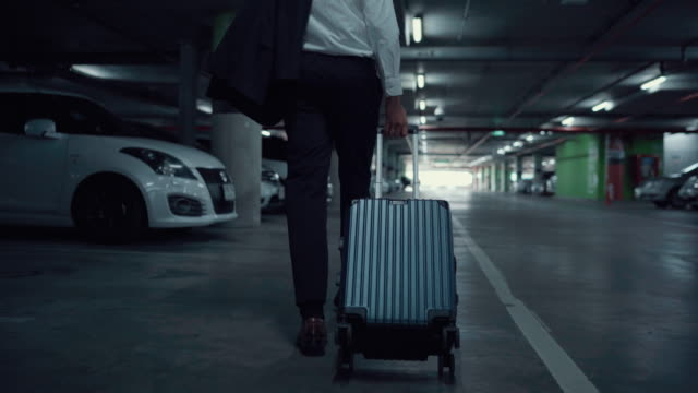 Businessman go back home on a airport after worked Asian Businessman go to parking for travel to home on a airport after worked button down shirt stock videos & royalty-free footage