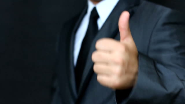 geschäftsmann gut läuft - menschlicher finger stock-videos und b-roll-filmmaterial