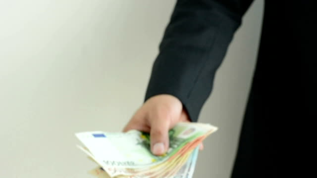 Businessman hand giving money - Euro currency (EUR) video