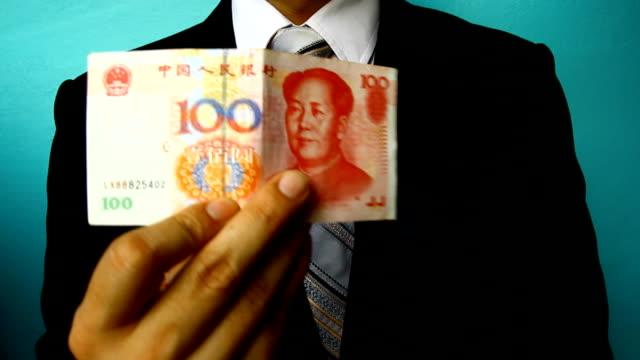 businessman hand hold china money bill