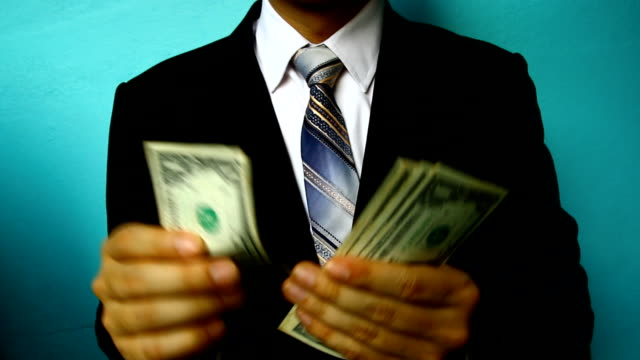 businessman hand hold money video