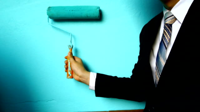 businessman hand hold Paint Roller video