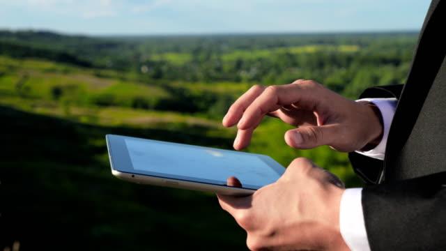 Businessman Hand Touching Digital Tablet video