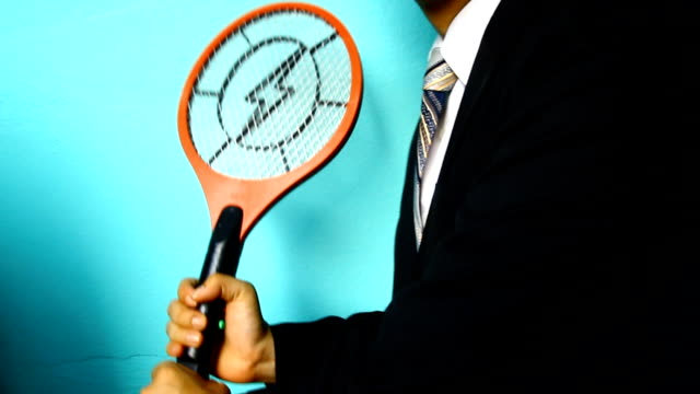 businessman hand with mosquito swatter