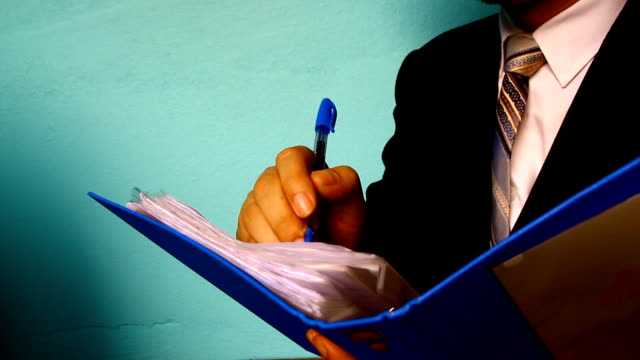 businessman hand with paper document video