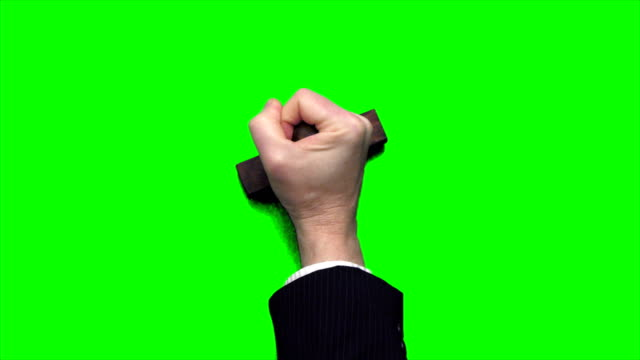 Businessman Hand with Rubber Stamp on Green Screen 4k clip of a businessman's hand stamping blank messages onto a chroma key green screen background. stamp stock videos & royalty-free footage