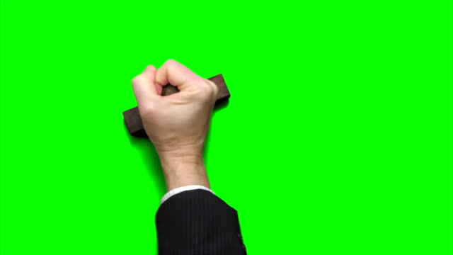 Businessman Hand with Rubber Stamp on Green Screen