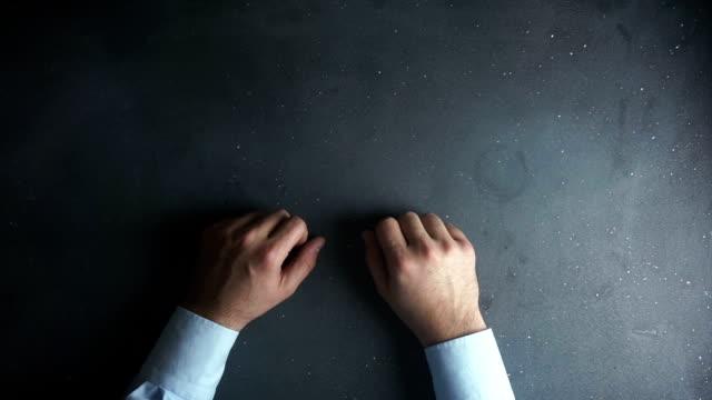 Businessman hands on black desk waiting video